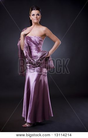 Beautiful young woman posing, wearing a light purple evening dress with stole.?