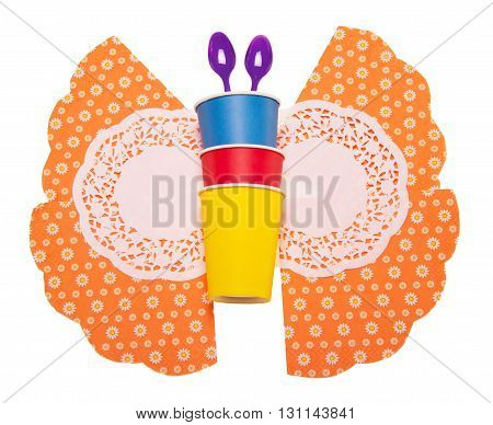 Bright disposable cups, spoons, and napkins folded into the shape of a butterfly isolated on white background.