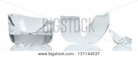 Fragments of broken glass close-up isolated on white background.