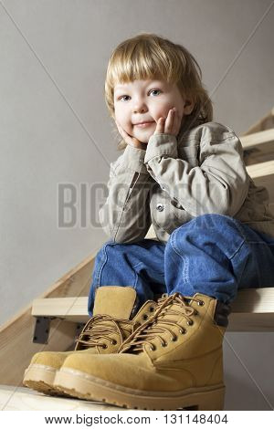 Big shoes to fill, child's feet in the large shoe