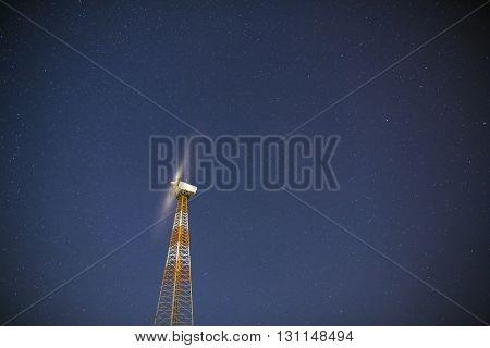 Windmill turbines on the stars night sky