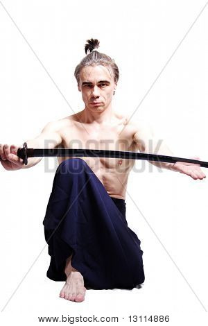 Samurai with sword. Shot in studio.
