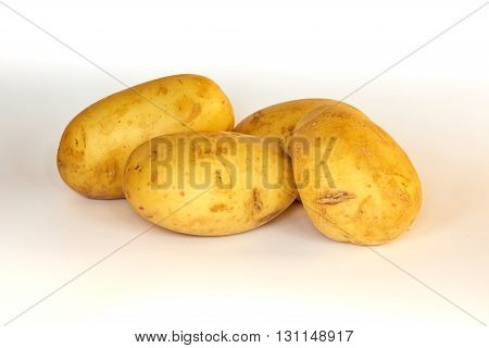 Potatoes unpeeled partly isolated on white background.