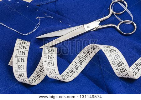 Sewing tools and sewing kit on a blue cloth