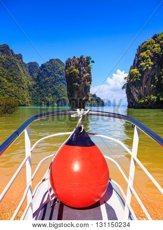 The holiday in Thailand. Bay in the Andaman Sea and tropical exotic island. A boat trip with a red lantern