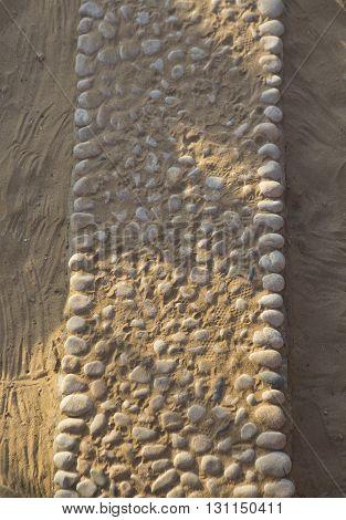 Gravel path on beach sand on a tropical resort