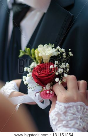 Female Hands Putting Boutonniere