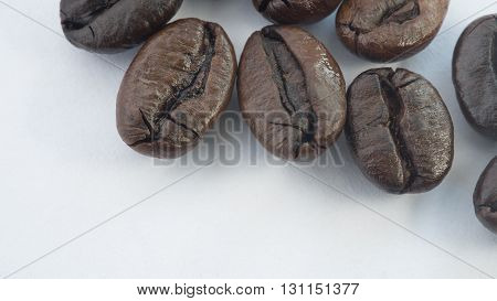 Fresh roasted coffee beans, in selective focus
