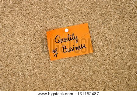 Quality Of Business Written On Orange Paper Note