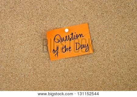 Question Of The Day Written On Orange Paper Note
