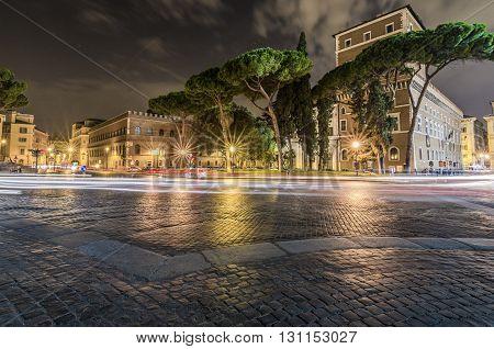 Italy, Rome, Piazza Venezia - Trails of light in front of Vittoriano