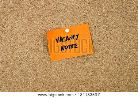 Vacancy Notice Written On Orange Paper Note