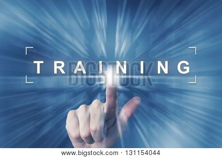 hand clicking on training button with zoom effect background