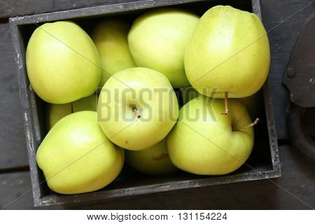 green apples on a black wooden background
