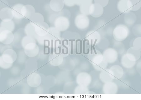 Abstract circular grey and white light bokeh background