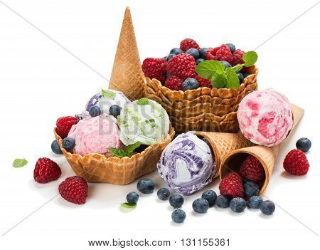 Ice cream of berry in a cones and baskets (blueberry raspberry) isolated on white background.