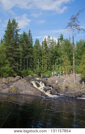 RUSKEALA, RUSSIA - AUGUST 09, 2014: Excursion to the waterfall Ahvenkoski (Ruskeala waterfall) on a sunny summer day. Main landmark of the Karelia