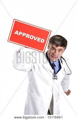 Portrait of senior doctor with approved table.