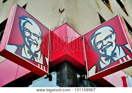 BELGRADE SERBIA - MAY 1: Logotype of KFC restaurant in city of Belgrade on May 1 2016. KFC is an international fast food chain founded in USA.