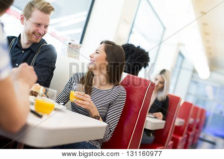 Friends Eating At The Table In The Diner