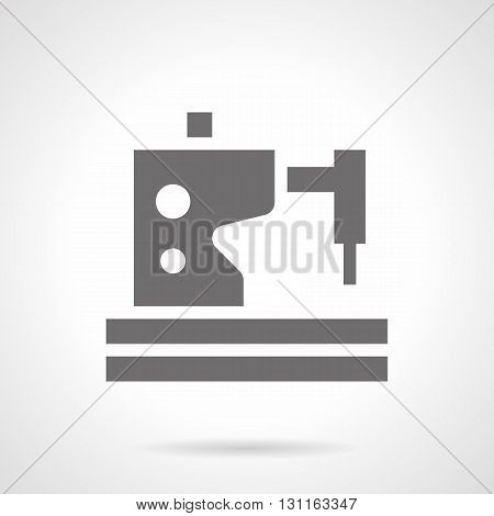 Monochrome silhouette of sewing machine. Professional service for sewing equipment in workshops and factories, repair of broken home sewing appliances. Symbolic black glyph style vector icon.