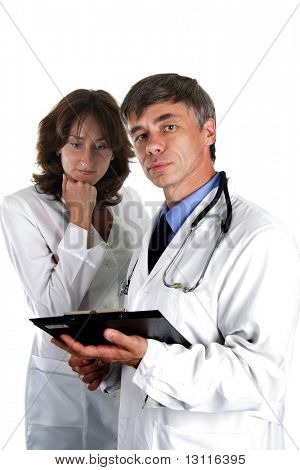 Two doctors review some case notes. Isolated with clipping path.