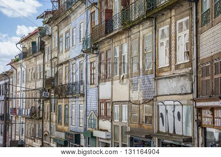 PORTO, PORTUGAL - APRIL 20, 2016: Traditional tiles on houses in Porto, Portugal