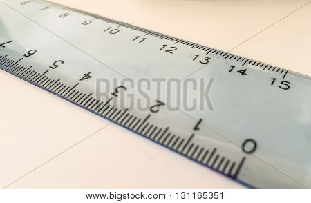 plastic centimeter ruler on a white plain