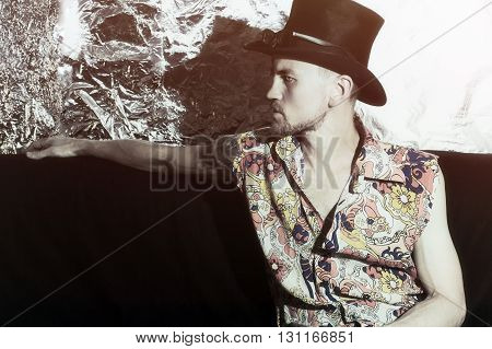 Portrait of young handsome man on metallic background