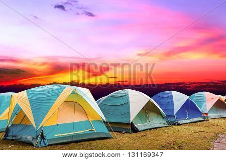 colorful tourist tent with beautiful sunset background