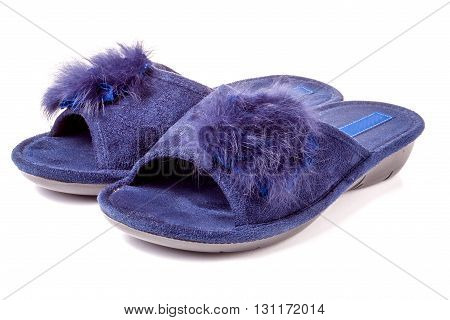 female house slippers with fur on white background.
