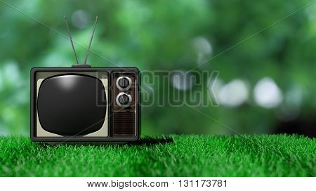 Antique TV set on green grass with abstract nature background. 3D rendering