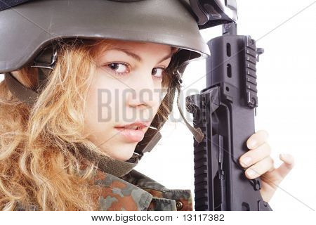 Shot of a beautiful girl holding gun. Uniform conforms to special services(soldiers) of the NATO countries. Shot in studio. Isolated on white.