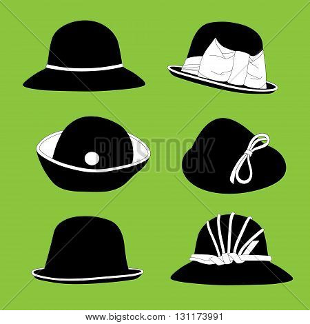 Black and white vintage hats on green