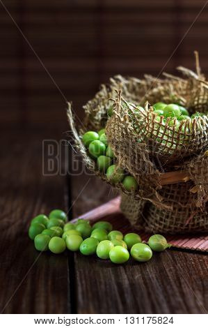 Green Peas On Wooden Background