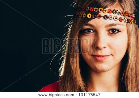 Attractive blonde woman with a retro headband - isolated on black.