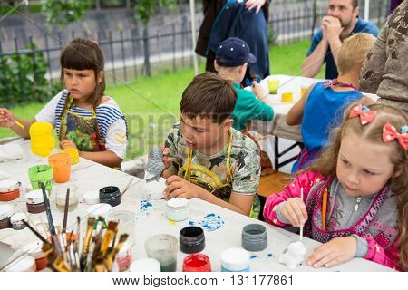 ST. PETERSBURG RUSSIA - JULY 26 2015: City holiday in Kronstadt. An unidentified children painted animal figurines on a city festival on the day of the Navy