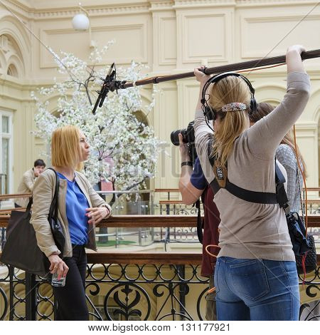 Moscow, Russia - May, 23, 2016: journalists interview in the Main department store in Moscow, Russia