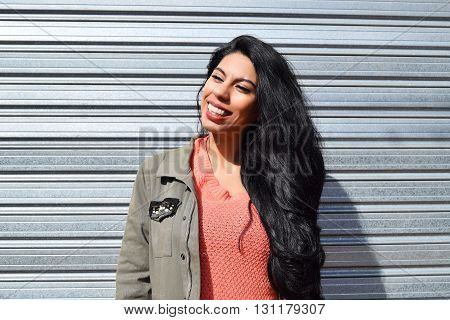 Portrait Of A Young Latin Woman Outdoors