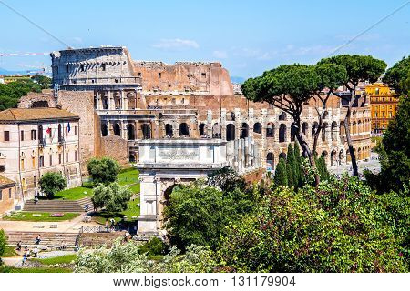 view of the Coliseum fro the Roman Forum in Rome Italy