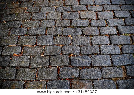 Closeup shot of cobblestone road in Colonia Uruguay. Traditional old street.