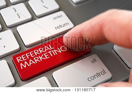 Selective Focus on the Referral Marketing Button. Man Finger Pressing Referral Marketing Button on Modernized Keyboard. Close Up view of Male Hand Touching Referral Marketing Computer Button. 3D.