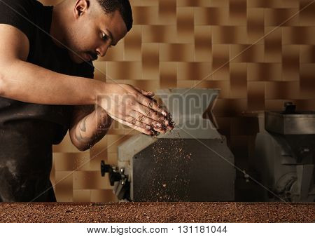 Professional Baker Pours Grained Nuts On Mold Filled With Melted Chocolate Mass. Preparation Of Tast