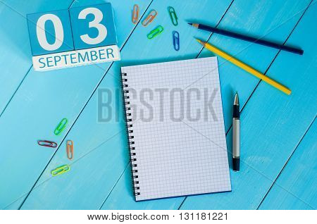 September 3rd. Image of september 3 wooden color calendar on white background workplace. Autumn day.