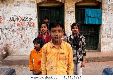 KOLKATA, INDIA - JAN 17, 2013: Unidentified children pose outdoor after school classes on January 17, 2013 in Kolkata India. Kolkata's literacy rate of 87.14 perc. exceeds the all-India average of 74 perc.