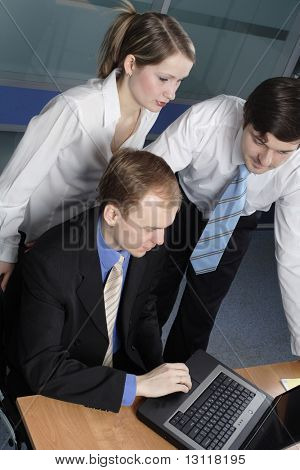 Group of 3 business people working together in the office.