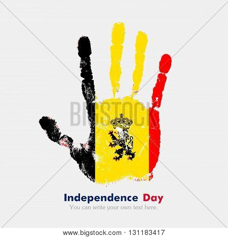 Hand print, which bears the Flag of Belgium. Independence Day. Grunge style. Grungy hand print with the flag. Hand print and five fingers. Used as an icon, card, greeting, printed materials.