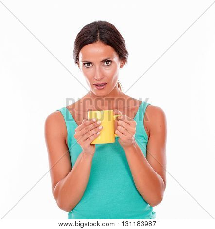 Surprised Young Brunette With Coffee Mug