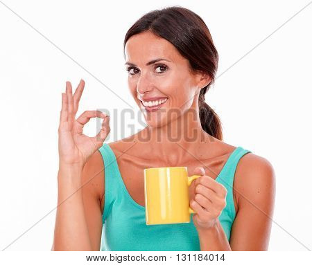 Celebrating Brunette Woman With Coffee Mug