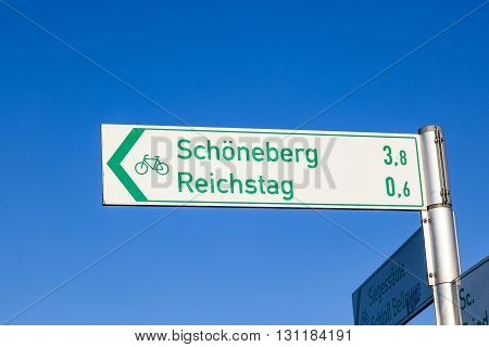 sign for tourists direction reichstag and SChoenefeld in Berlin Germany